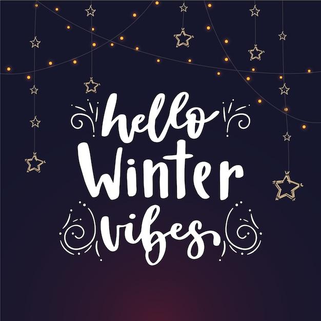 Hallo winter belettering met sterren Gratis Vector