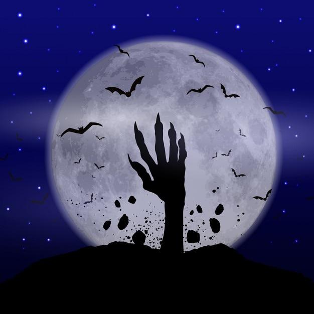 Halloween achtergrond met de hand zombie losbarsten uit de grond Gratis Vector