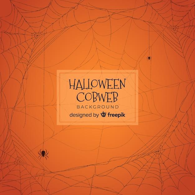 Halloween-achtergrond met hand getrokken spinneweb Gratis Vector