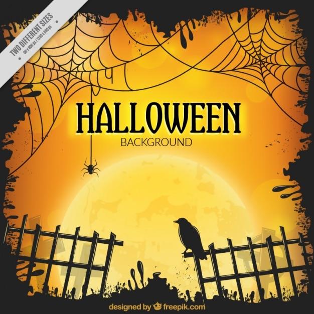 Halloween achtergrond met hek en een raaf Gratis Vector