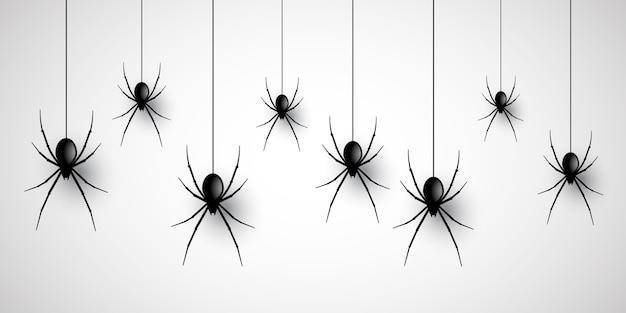 Halloween-bannerontwerp met hangende spinnen Gratis Vector