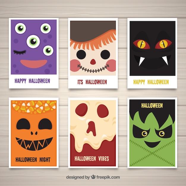 Halloween kaarten met monster gezichten Gratis Vector