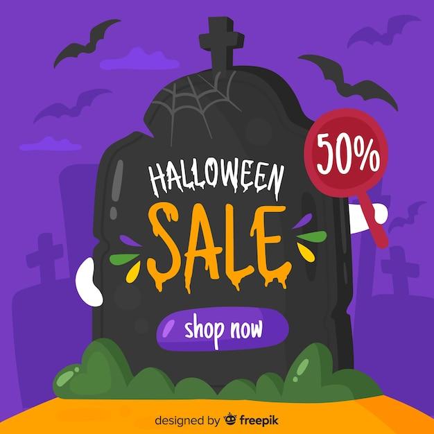 Halloween-verkoop op een grafsteen in nacht Gratis Vector