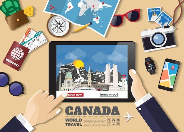 Hand die slimme tablet het boeken reisbestemming houden. de beroemde plaatsen van canada. Premium Vector