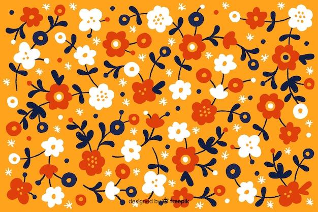 Hand getekend floral achtergrond Gratis Vector