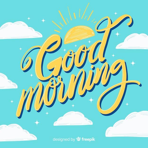 Hand getekend goedemorgen belettering achtergrond Gratis Vector