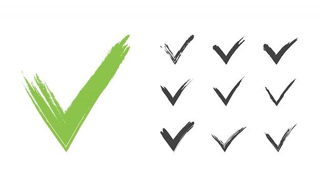 Hand getekend groen grunge vinkje set Premium Vector