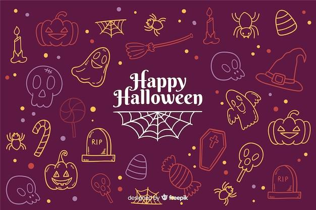 Hand getekend halloween achtergrond met doodles Gratis Vector