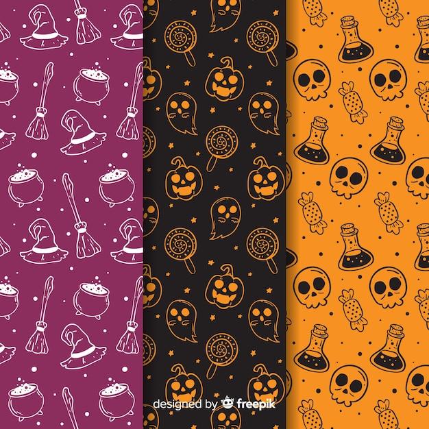 Hand getekend halloween patroon collectie in negatief Gratis Vector