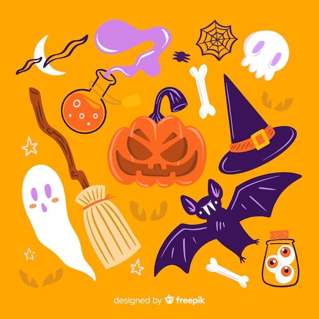 Hand getekend halloween set schattige elementen op oranje achtergrond Gratis Vector