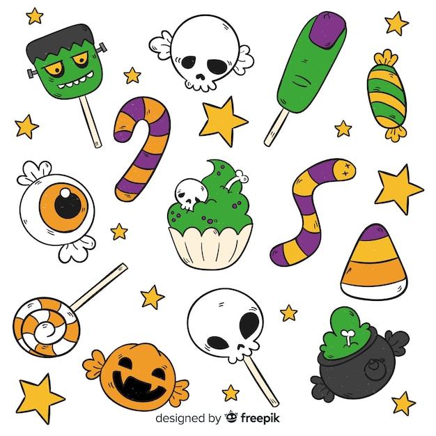 Hand getekend halloween snoep collectie Gratis Vector
