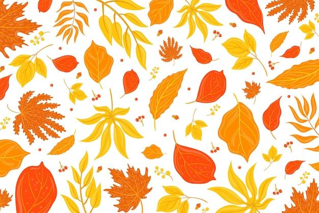 Hand getekend herfstbladeren achtergrond Gratis Vector