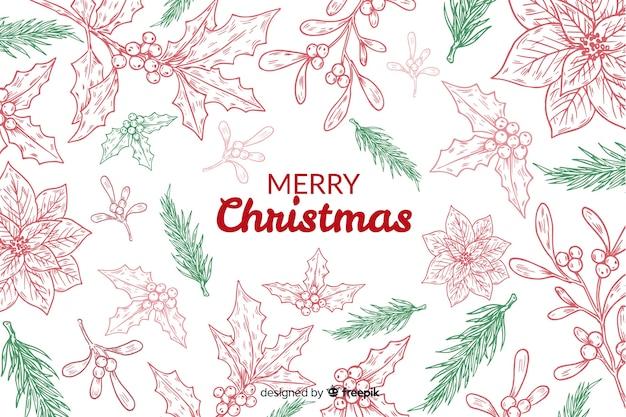 Hand getekend kerst achtergrond Gratis Vector