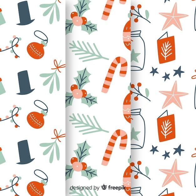 Hand getekend kerst patroon collectie Gratis Vector