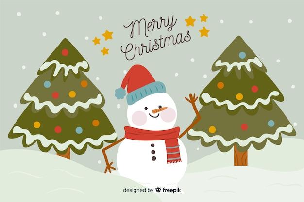 Hand getekend kerst sneeuwpop achtergrond Gratis Vector