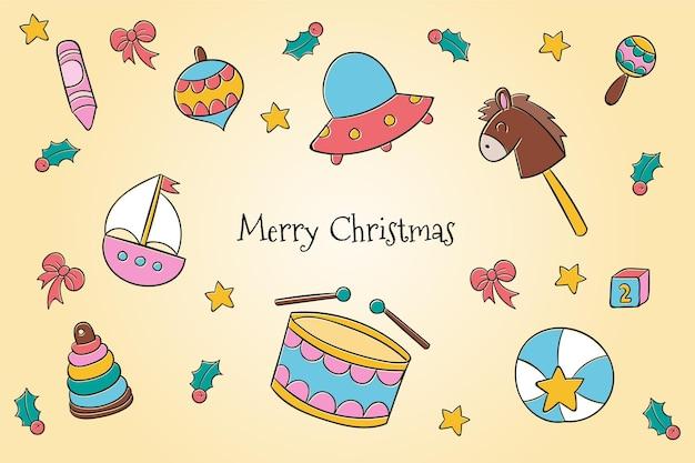 Hand getekend kerst speelgoed achtergrond Gratis Vector
