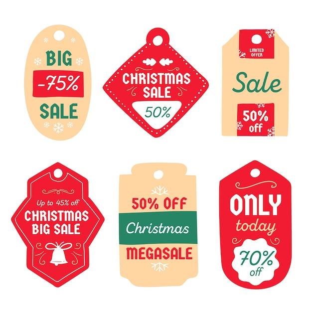 Hand getekend kerst verkoop tag collectie Gratis Vector