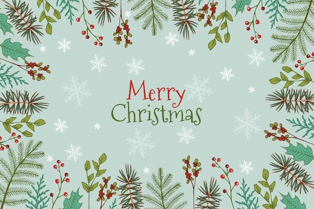 Hand getekend kerstboom takken achtergrond Gratis Vector