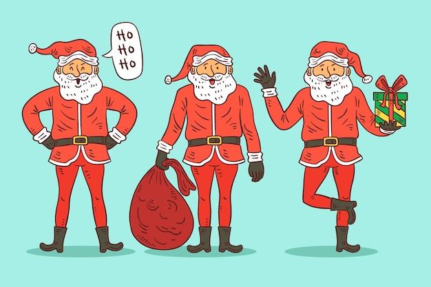 Hand getekend kerstman tekens Gratis Vector
