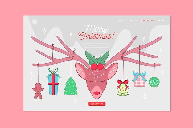Hand getekend kerstmis bestemmingspagina met roze rendieren Gratis Vector