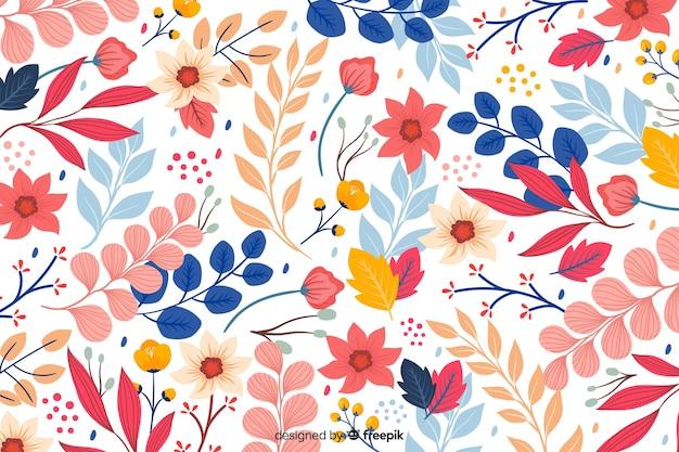 Hand getekend kleurrijke bloemen achtergrond Gratis Vector