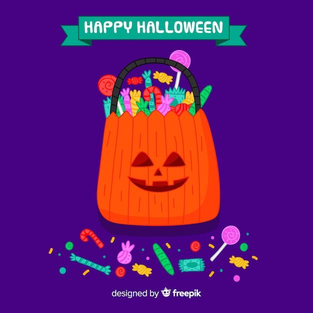 Hand getekend kleurrijke halloween snoep tas achtergrond Gratis Vector