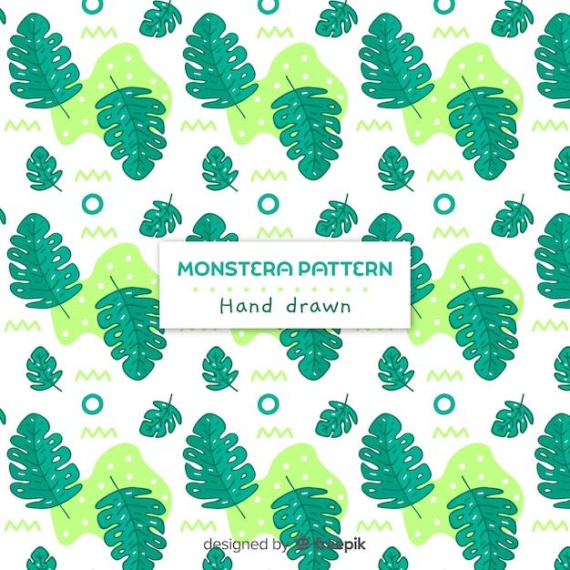 Hand getekend monstera patroon Gratis Vector