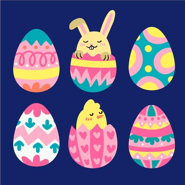 Hand getekend paasdag eieren met konijn en kip Gratis Vector