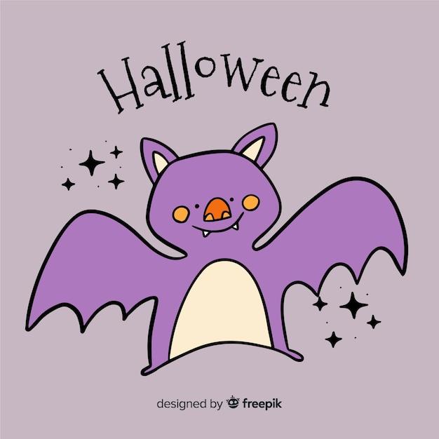 Hand getekend schattig halloween vleermuis Gratis Vector