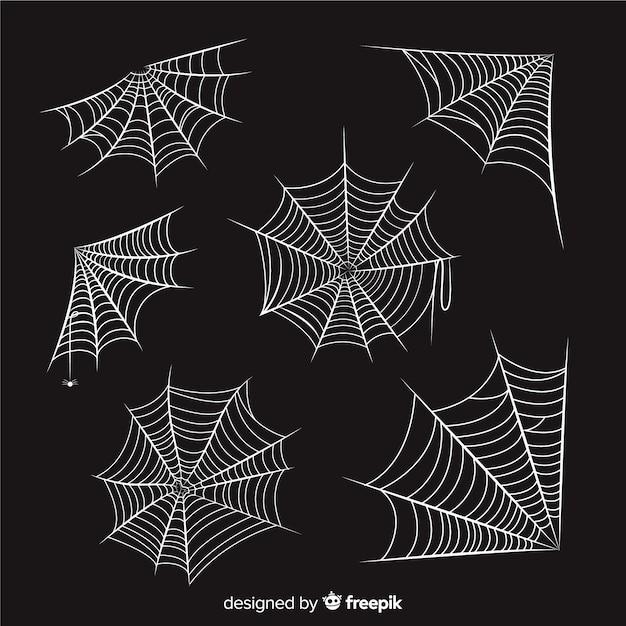 Hand getekend spinnenweb collectie op zwarte achtergrond Gratis Vector