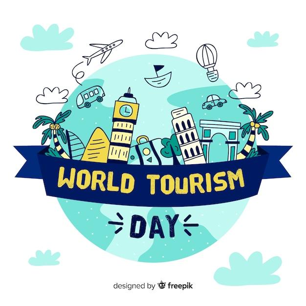 Hand getekend toerisme dag achtergrond Gratis Vector