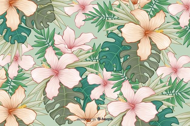 Hand getekend tropische bloemen achtergrond Gratis Vector
