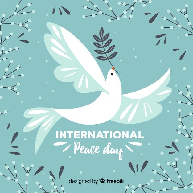 Hand getekend vredesdag achtergrond met duif Gratis Vector