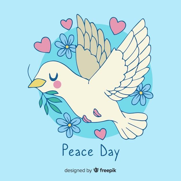 Hand getekend vredesdag duif Gratis Vector