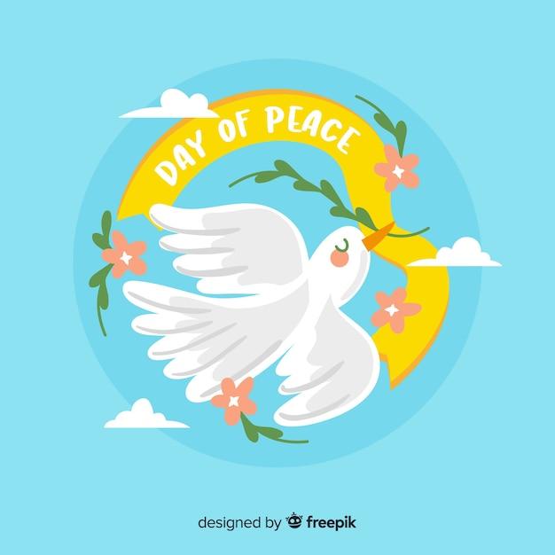 Hand getekend vredesdag met een duif Gratis Vector