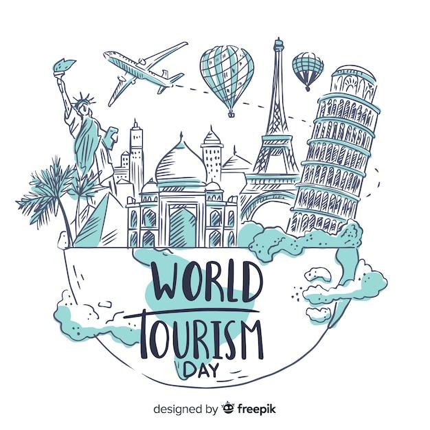 Hand getekend wereld toerisme dag met beroemde bezienswaardigheden Gratis Vector