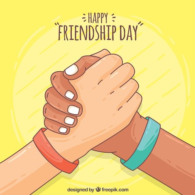 Hand getekende vriendschap gelukkige dag achtergrond Gratis Vector