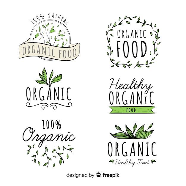 Hand getrokken biologisch voedseletiket ingesteld Gratis Vector