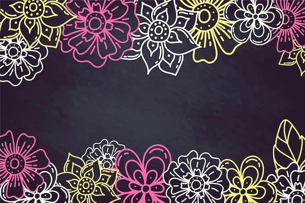 Hand getrokken bloemen op schoolbord achtergrond Gratis Vector