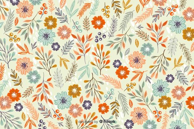 Hand getrokken bloemenpatroonachtergrond Gratis Vector