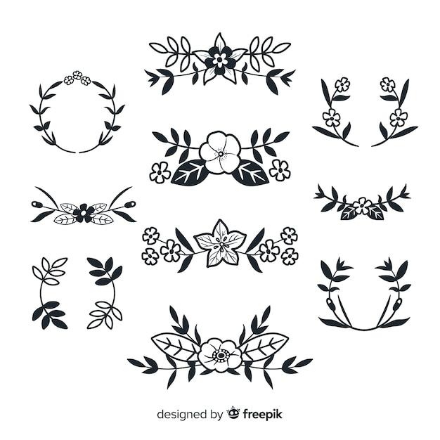 Hand getrokken florale decoratie-elementen Gratis Vector