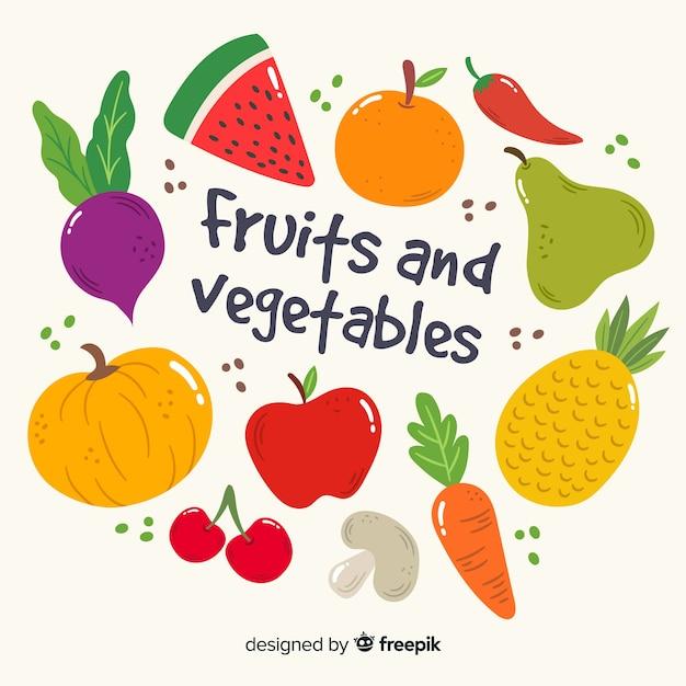 Hand getrokken groenten en fruit achtergrond Gratis Vector