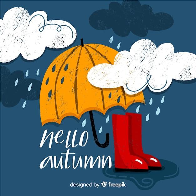 Hand getrokken hallo herfst belettering achtergrond Gratis Vector