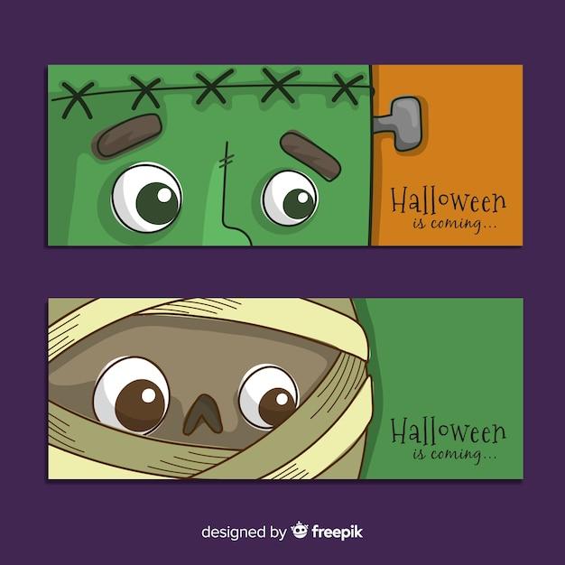 Hand getrokken halloween-de gezichten van het bannersclose-upmonster Gratis Vector