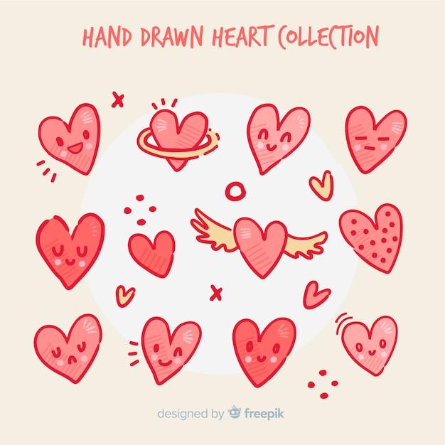 Hand getrokken hartcollectie Gratis Vector