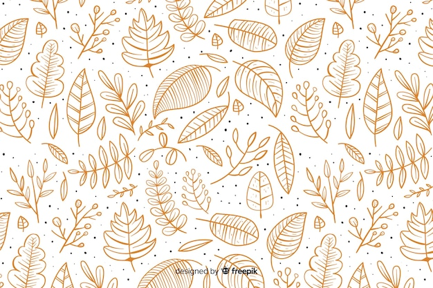 Hand getrokken herfst achtergrond met bladeren Gratis Vector