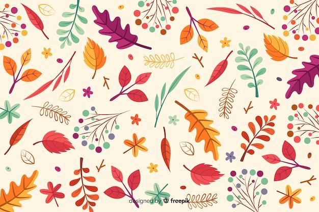 Hand getrokken herfstbladeren achtergrond Gratis Vector