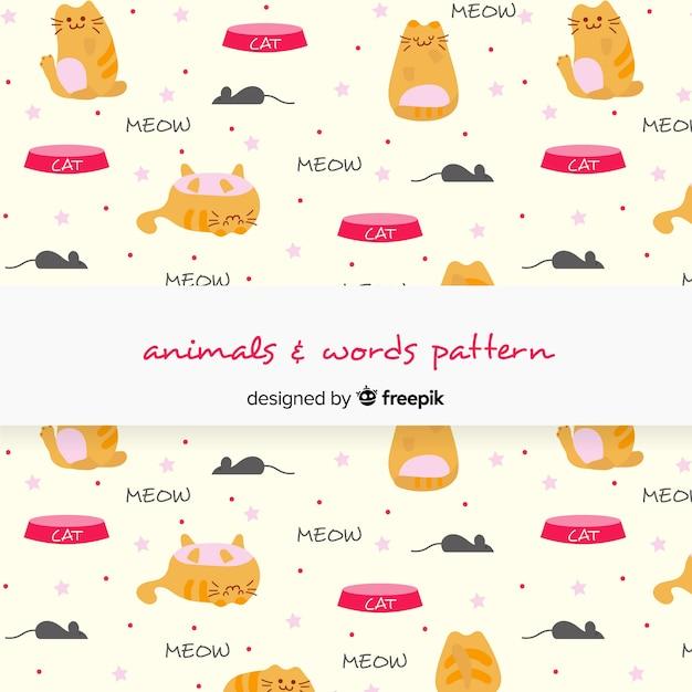 Hand getrokken katten en woordenpatroon Gratis Vector