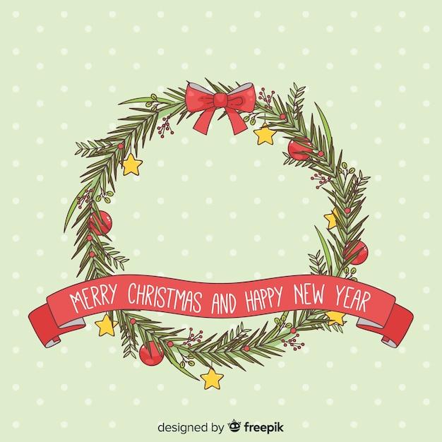 Hand getrokken kerst krans achtergrond Gratis Vector