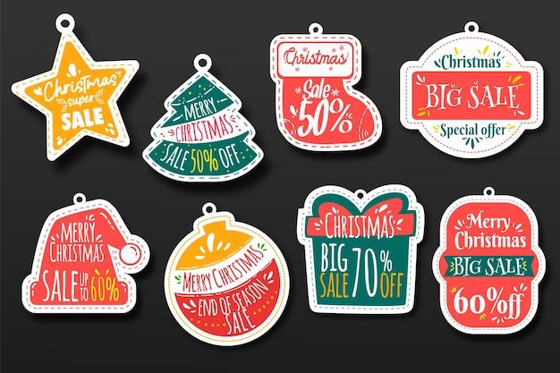 Hand getrokken kerst verkoop tag collectie Gratis Vector